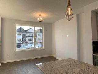 Photo 8: 1052 Lanark Boulevard SE: Airdrie Row/Townhouse for sale : MLS®# A1052705