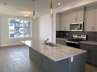 Photo 4: 1052 Lanark Boulevard SE: Airdrie Row/Townhouse for sale : MLS®# A1052705