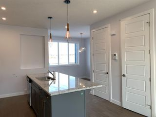 Photo 7: 1052 Lanark Boulevard SE: Airdrie Row/Townhouse for sale : MLS®# A1052705
