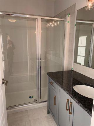 Photo 11: 1052 Lanark Boulevard SE: Airdrie Row/Townhouse for sale : MLS®# A1052705