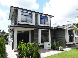 Photo 1: 1828 ISLAND AV in Vancouver: Fraserview VE House for sale (Vancouver East)  : MLS®# V1140847