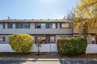 Photo 1: 74 740 Bracewood Drive SW in Calgary: Braeside Row/Townhouse for sale : MLS®# A1038575