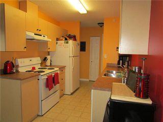 "Photo 2: 408 8507 86TH Street in Fort St. John: Fort St. John - City SE Condo for sale in ""WOODSMERE PARK"" (Fort St. John (Zone 60))  : MLS®# N227356"