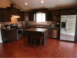 Photo 2: 2402 KITCHENER AV in Port Coquitlam: Woodland Acres PQ House for sale : MLS®# V1126516