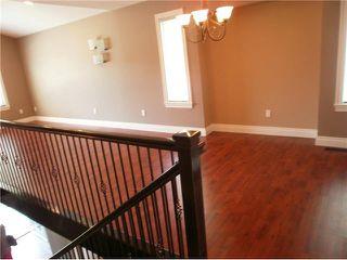 Photo 5: 2402 KITCHENER AV in Port Coquitlam: Woodland Acres PQ House for sale : MLS®# V1126516