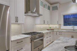 Photo 11: 6316 LONGMOOR Way SW in Calgary: Lakeview Detached for sale : MLS®# A1035588