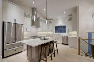 Photo 16: 6316 LONGMOOR Way SW in Calgary: Lakeview Detached for sale : MLS®# A1035588