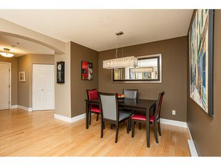 "Photo 7: 302 20120 56 Avenue in Langley: Langley City Condo for sale in ""Blackberry Lane 1"" : MLS®# R2506243"