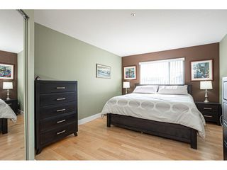 "Photo 13: 302 20120 56 Avenue in Langley: Langley City Condo for sale in ""Blackberry Lane 1"" : MLS®# R2506243"