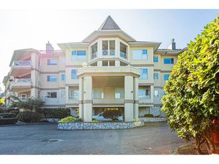 "Photo 1: 302 20120 56 Avenue in Langley: Langley City Condo for sale in ""Blackberry Lane 1"" : MLS®# R2506243"