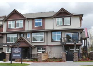 Photo 1: 114 19525 73rd in Surrey: Townhouse for sale