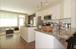 Photo 3: 114 19525 73rd in Surrey: Townhouse for sale