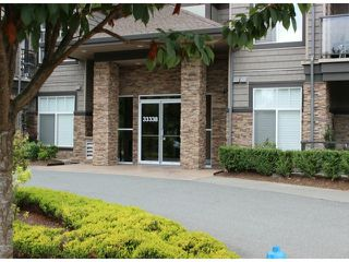 "Photo 1: 401 33338 MAYFAIR Avenue in Abbotsford: Central Abbotsford Condo for sale in ""THE STIRLING ON MAYFAIR"" : MLS®# F1420645"