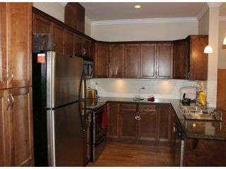 "Photo 3: 401 33338 MAYFAIR Avenue in Abbotsford: Central Abbotsford Condo for sale in ""THE STIRLING ON MAYFAIR"" : MLS®# F1420645"
