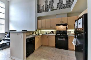 Photo 2: 419 10866 CITY PARKWAY in Surrey: Whalley Condo for sale (North Surrey)  : MLS®# R2140273