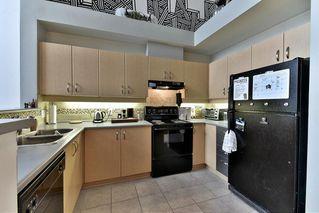 Photo 3: 419 10866 CITY PARKWAY in Surrey: Whalley Condo for sale (North Surrey)  : MLS®# R2140273