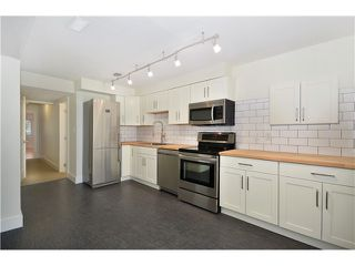 """Photo 9: 527 E 30TH Avenue in Vancouver: Fraser VE House for sale in """"MAIN"""" (Vancouver East)  : MLS®# V1004528"""