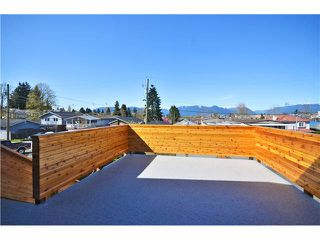 """Photo 7: 527 E 30TH Avenue in Vancouver: Fraser VE House for sale in """"MAIN"""" (Vancouver East)  : MLS®# V1004528"""