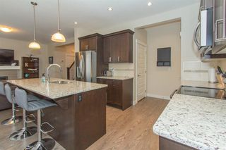 Photo 7: 1601 1086 Williamstown Boulevard NW: Airdrie Row/Townhouse for sale : MLS®# A1038229