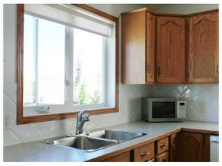 Photo 8: 124 BOW RIDGE Court: Cochrane Residential Detached Single Family for sale : MLS®# C3628398