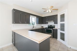 Photo 10: 27 Beaver Place: Beiseker Detached for sale : MLS®# C4306269