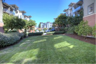 "Photo 7: 207 33539 HOLLAND Avenue in Abbotsford: Central Abbotsford Condo for sale in ""The Crossing"" : MLS®# R2497878"