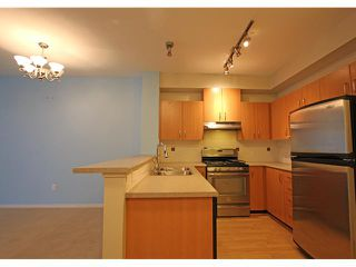 Photo 4: # 106 801 KLAHANIE DR in Port Moody: Port Moody Centre Condo for sale : MLS®# V1056991