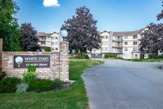 "Photo 1: 310 5710 201 Street in Langley: Langley City Condo for sale in ""White Oaks"" : MLS®# R2453667"