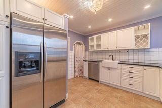 Photo 6: 833 23 Avenue SE in Calgary: Ramsay Detached for sale : MLS®# A1054731