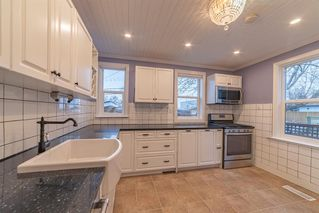Photo 5: 833 23 Avenue SE in Calgary: Ramsay Detached for sale : MLS®# A1054731