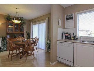 Photo 3: 135 Stonemere Place: Chestermere Residential Attached for sale : MLS®# C3623986