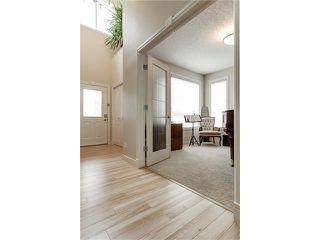Photo 5: 118 PANATELLA CI NW in Calgary: Panorama Hills House for sale : MLS®# C4078386