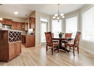 Photo 10: 118 PANATELLA CI NW in Calgary: Panorama Hills House for sale : MLS®# C4078386