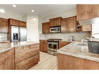Photo 13: 118 PANATELLA CI NW in Calgary: Panorama Hills House for sale : MLS®# C4078386