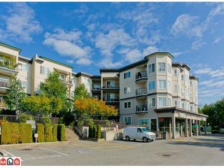 "Photo 1: 115 5765 GLOVER Road in Langley: Langley City Condo for sale in ""College Court"" : MLS®# F1209579"