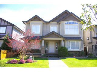 "Photo 1: 11372 240TH Street in Maple Ridge: Cottonwood MR House for sale in ""SEIGLE CREEK"" : MLS®# V975252"