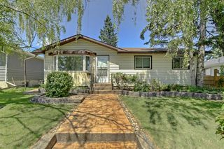 Main Photo: 608 84 Avenue SW in Calgary: Haysboro Detached for sale : MLS®# A1009582
