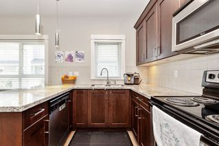 """Photo 3: 21 1130 EWEN Avenue in New Westminster: Queensborough Townhouse for sale in """"Gladstone Park"""" : MLS®# R2479341"""