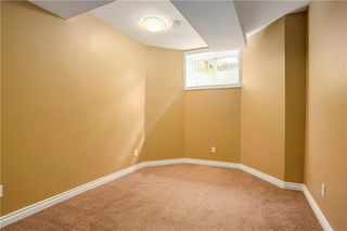Photo 18: 415 52 Avenue SW in Calgary: Windsor Park Semi Detached for sale : MLS®# A1042308