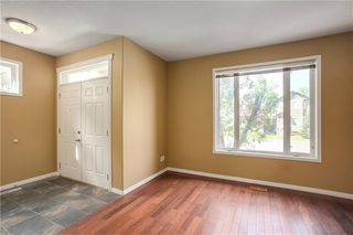 Photo 2: 415 52 Avenue SW in Calgary: Windsor Park Semi Detached for sale : MLS®# A1042308