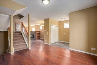 Photo 3: 415 52 Avenue SW in Calgary: Windsor Park Semi Detached for sale : MLS®# A1042308