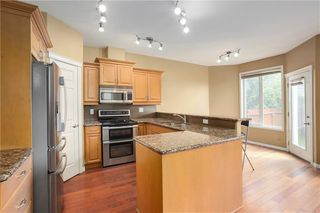Photo 6: 415 52 Avenue SW in Calgary: Windsor Park Semi Detached for sale : MLS®# A1042308