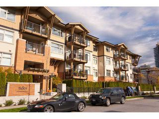 "Photo 1: 302 500 KLAHANIE Drive in Port Moody: Port Moody Centre Condo for sale in ""TIDES"" : MLS®# V935803"