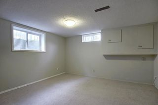 Photo 19: 9916 WALROND Road SE in Calgary: Willow Park Detached for sale : MLS®# A1022875
