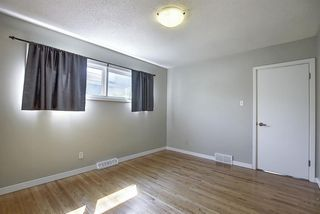 Photo 15: 9916 WALROND Road SE in Calgary: Willow Park Detached for sale : MLS®# A1022875