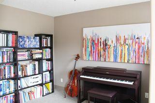 Photo 12: 47 ASPEN STONE Manor SW in Calgary: Aspen Woods Detached for sale : MLS®# A1028178