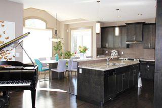 Photo 5: 47 ASPEN STONE Manor SW in Calgary: Aspen Woods Detached for sale : MLS®# A1028178