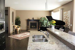 Photo 11: 47 ASPEN STONE Manor SW in Calgary: Aspen Woods Detached for sale : MLS®# A1028178