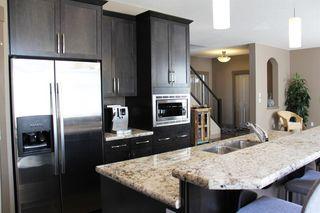 Photo 8: 47 ASPEN STONE Manor SW in Calgary: Aspen Woods Detached for sale : MLS®# A1028178