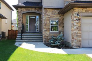 Photo 2: 47 ASPEN STONE Manor SW in Calgary: Aspen Woods Detached for sale : MLS®# A1028178